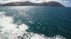 Boat Leaving Island Stock Footage