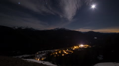 Cloudscapes moonlit skies with mountain views Stock Footage
