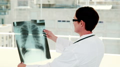 Doctor analyzing xray results Stock Footage