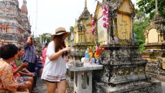 People celebrating Songkran (Thai new year / water festival) Ancestor Worship Stock Footage