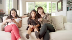 Family using technology together in living room Stock Footage