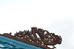 Borneo traditional tribal carvings on the roof top of buildings Stock Photos