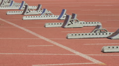 Female Sprinters getting into the starting blocks Stock Footage