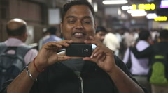 Portrait of an Indian man taking photo with a mobile phone. Stock Footage