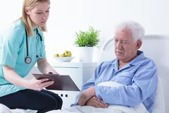 Doctor talking with patient - stock photo