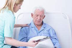 Doctor talking patient about cancer - stock photo