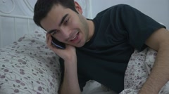 4K Men Talking To Cellphone In Bed - stock footage
