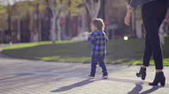 Closeup Of A Mother And Her Little Boy's Feet Walking Along A Path Stock Footage