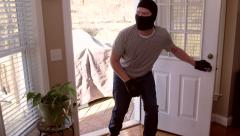 Thief breaking into house with ski mask Stock Footage