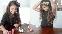 Young girls play checkers together Stock Footage