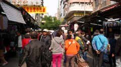 Promotion of the cleaning stuff on the busy market street Stock Footage