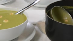 Split pea soup panning from pot to bowl Stock Footage