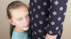 Blue eyed, blonde teenage girl hugging mom Stock Footage