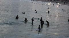 Silhouettes of brazilians enjoying sunset at the beach - Ipanema, Rio de Janeiro Stock Footage
