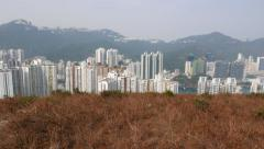 Many buildings next to hill edge, breathtaking view from mountain Stock Footage