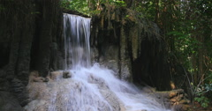 Seamless loop-able video background of small waterfall in tropical forest - stock footage