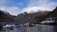 A view along the Geiranger Fjord, Norway. Boats in foreground Stock Footage