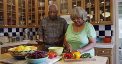 Mature black couple cooking together in kitchen Stock Footage
