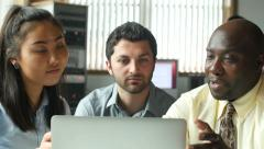 Diverse business professionals in team meeting at computer - stock footage