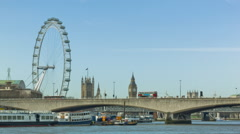 Red buses crossing the Waterloo Bridge, wide angle Stock Footage