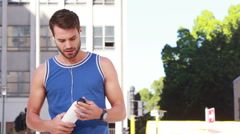 Happy jogger drinking water with thumb up Stock Footage