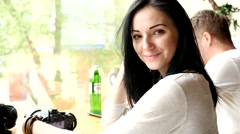 Young beautiful brunete woman portrait posing smiling on camera in cafe Stock Footage