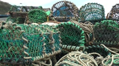 Fishing baskets nets ropes working colorful quayside Stock Footage