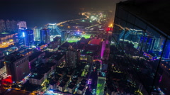 Shenzhen city night roof view reflection mirror building 4k time lapse china Stock Footage
