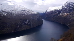 A view along the Geiranger Fjord, Norway. Sun spot Stock Footage