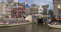 The Netherlands Amsterdam ctiy Holland canal canals dutch building house houses Stock Footage
