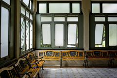 Interior of a hospitall waiting room with a view on windows. Day time, city l - stock photo