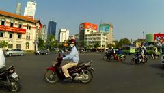 Ho Chi Minh City - April 2015: Roundabout walk, POV traffic. Speed up. Stock Footage