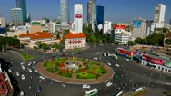 Stock Video Footage of Ho Chi Minh City - April 2015: Roundabout aerial view with traffic. 4K