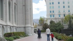 Young Family walking by Temple Square at Salt Lake City Utah Stock Footage