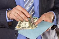 Counting dollars bribe - stock photo