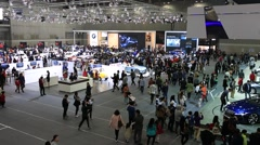 People looking around Motor show Stock Footage