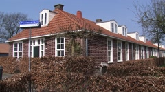 LELYSTAD Historic 1950s barracks on reclaimed land + pan courtyard Stock Footage