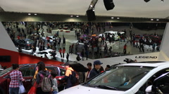 Time lapse of People looking around Motor show - stock footage