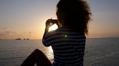 Woman Taking a Photograph with Smartphone at Sunset. Slow Motion Stock Footage