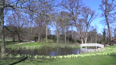 Rungstedlund, lake, bridge and bird sanctuary on a sunny spring day - stock footage