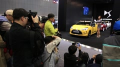 Photographers taking photos at Motor show Stock Footage