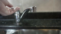 Home kitchen faucet running flowing water tap. Wasting, global warming Stock Footage
