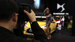 Photographer taking photos at Motor show Stock Footage