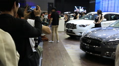 People taking photos at Motor show Stock Footage