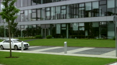 Exclusive Limousine, Elegant, sporty Audi A8 L driving by modern business center Stock Footage