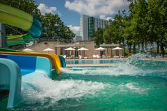 Person riding down a water slide Stock Photos