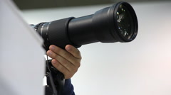Photographer taking photos with big camera Stock Footage