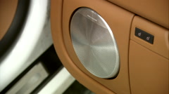 Close up of modern beige leather car interior,  Bang and Olufsen Sound System Stock Footage