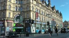 Victorian Architecture busy street scene Leeds Kirkgate market Stock Footage