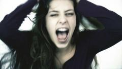 Desperate girl screaming and shouting medium shot slow motion Arkistovideo